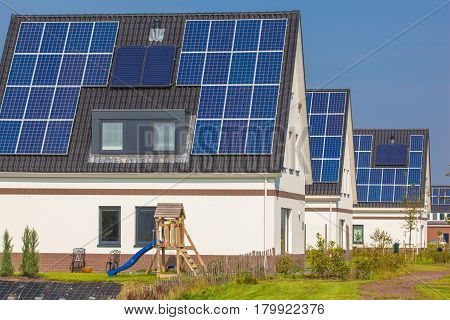 New Houses With Solar Panels In A Modern Street