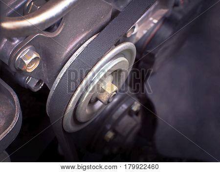 Close up car timing belt in engine room.