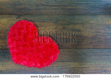 Heart shaped pillow on wooden background Valentine's day concept