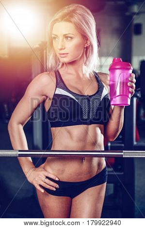 Pretty Caucasian Fitness Girl Drinking Protein Powder From Shaker