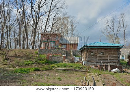 The country-cottage with vegetable-garden and bathhouse. Spring.