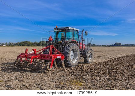 Working Tractor With Plough