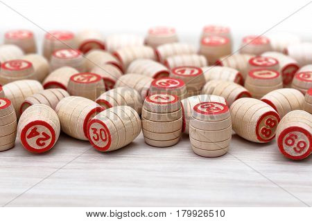 Wooden kegs for lotto closeup with blurred background