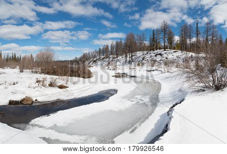 Spring landscape with a stream in South Yakutia Russia