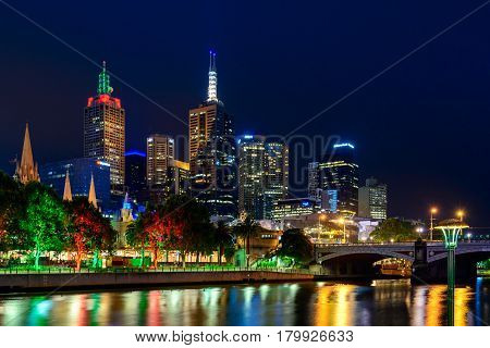 Melbourne Australia - December 27 2016: Melbourne city buildings illumination at night viewed across the Yarra river
