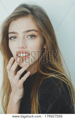 Pretty Smiling Girl Putting Gel Or Balm On Sexy Lips