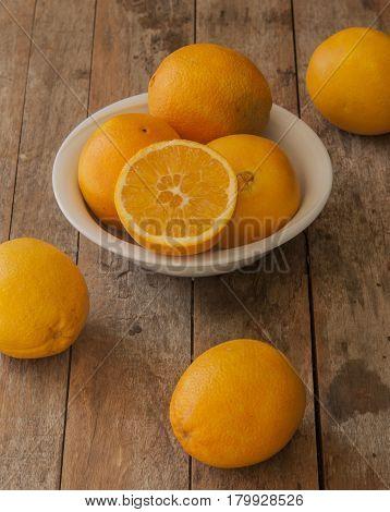 Mandarin Oranges - mandarin oranges on a rustic wooden board.