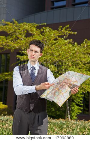 businessman pointing at map