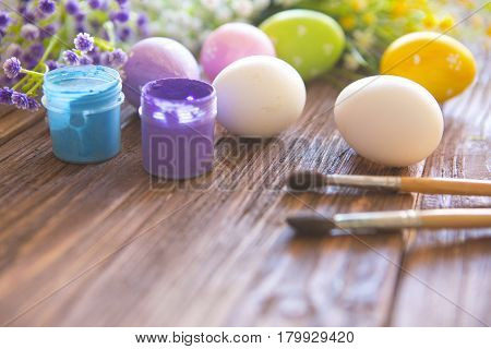 Easter Eggs For Coloring, Flowers And Paintbrush For Easter On Wooden Table Background.