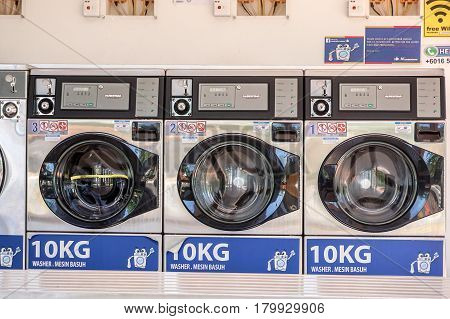 Labuan,Malaysia-Apr 3,2017:View of laundry into coin-operated washing machines at laundromats self operated laundry in Labuan,Malaysia on 3rd April 2017.