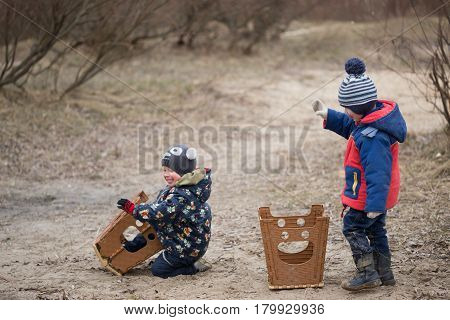 Gomel, Belarus - 25 March 2017: Camping. Children Play With Plastic Chairs.