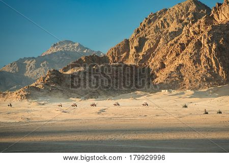 Extreme entertainment in the desert on 4-wheelers. Rally in desert of Sinai peninsula