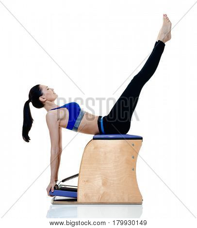 one caucasian woman exercising fitness pilates exercices isolated on white background