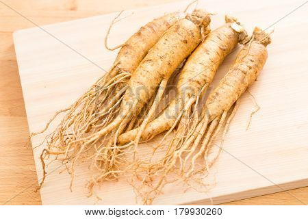 Ginseng over wood background