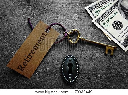 Gold key and lock with money and Retirement message
