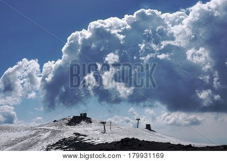 cloudscape on skilift of Montagnola in winter Etna Park, Sicily