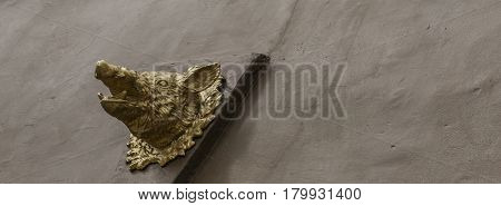 Beautiful Decoration On The Building, Gold Head Boar, Decoration On The Brown Facade,