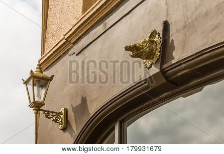 Beautiful Decoration On The Building, Gold Head Boar, Decoration On The Brown Facade, Old Lamp