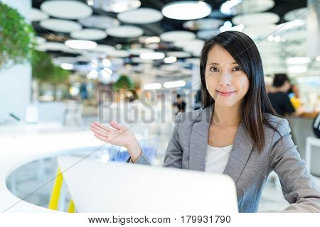 Businesswoman working on laptop computer in share office