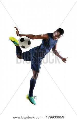 Young African American soccer player kicking ball with heel - Also known as Scorpion kick