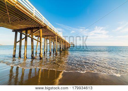 Malibu pier at sunset in California, usa