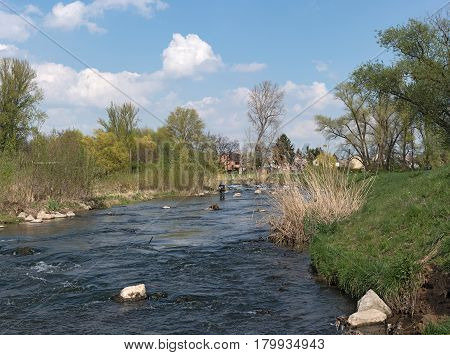 FRANKFURT, GERMANY-APRIL 04, 2017: Fly fishing in the renatured Nidda River