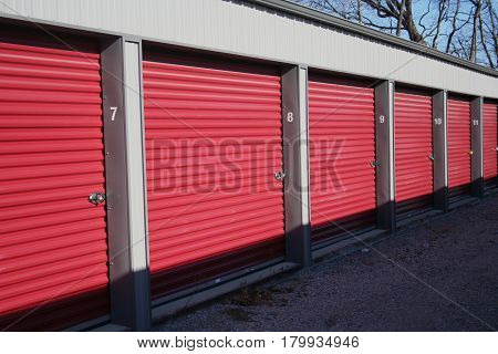 A row of self storage units with over-head style doors.