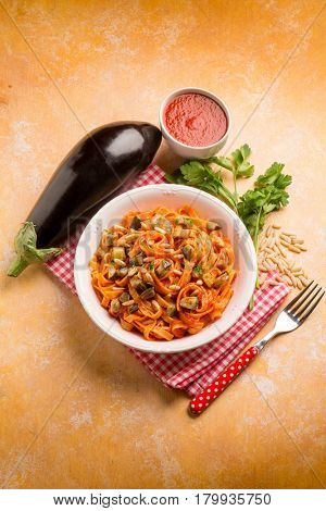 tagliatelle with eggplant tomato sauce and pine nuts