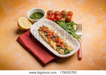 tofu salad with tomatoes marinated with arugula pesto and lemon