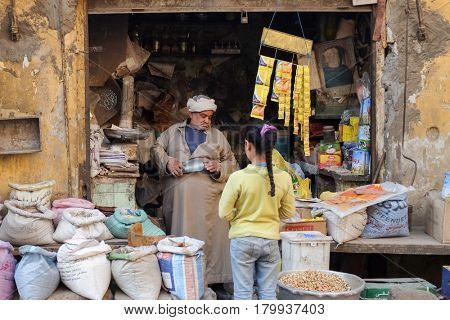 CAIRO, EGYPT - JANUARY 23, 2016: A traditional small shop and a child customer in the Capital City Cairo, Egypt.