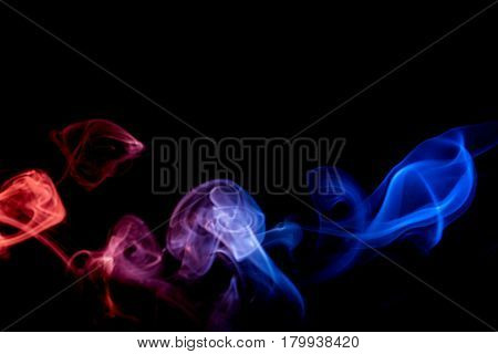 the abstract colorful smoke on dark background