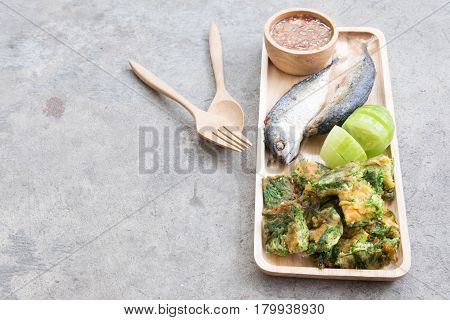 Thai local popular food as spicy shrimp paste dip (Nam Prik Kapi in Thai) served with fried mackerels sliced cucumber and fried acacia pennata omelet