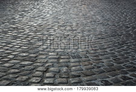 Empty old cobblestone street background with copy space