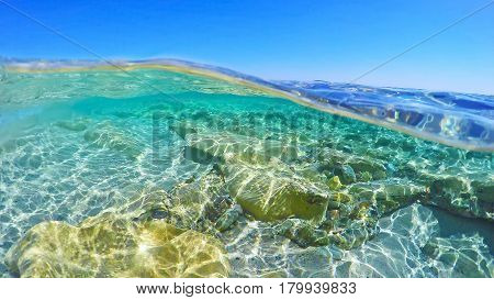 a turquoise water in Sardinia in Italy