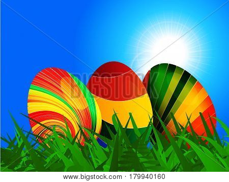 Colourful striped Easter eggs on Green Grass Over Blue Sunny Sky Landscape Background