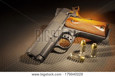 Semi automatic pistol with ammunition on a rubber mat