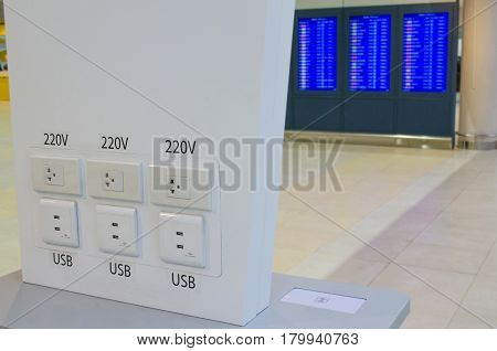 free battery charger counter in transportation terminal at the airport usb plug selective focus.