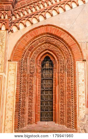 window of gothic style of medieval age with decorations made of terracotta / window of gothic style