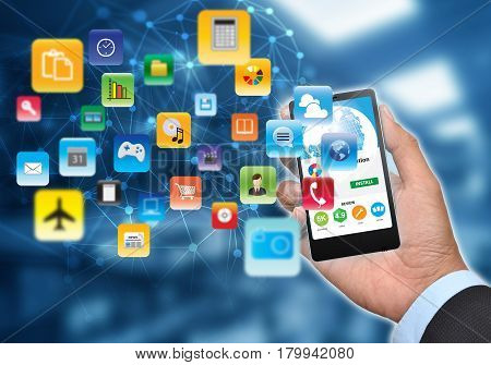 businessman hand showing icons of software and application available on the internet
