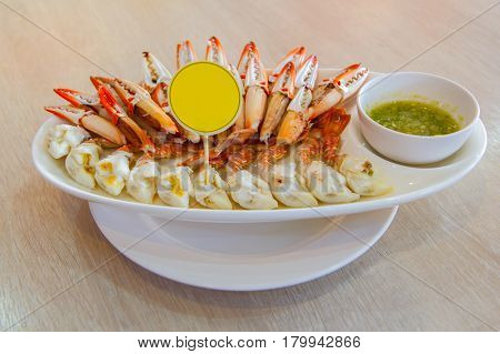 Steamed Crab Legs Sea food background Boiled crab claws with orange sauce selective focus