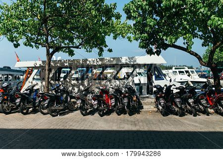 Male, Maldives - December 17, 2016: Motorcycles And Boats In The City Of Male, The Capital Of The Ma