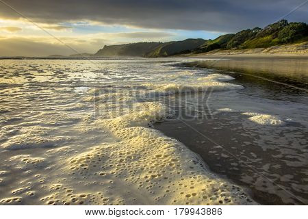 Foam On The Surf Of Pakiri Coast, New Zealand