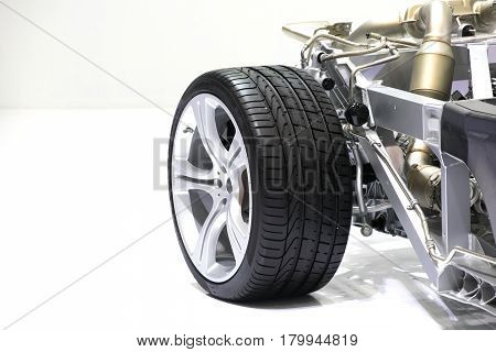 wheel Car chassis with engine. Image of car chassis with engine isolated on white.