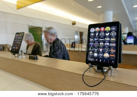New York March 18 2017: iPads are freely offered to airline passengers at the jetBlue terminal of the JFK airport.