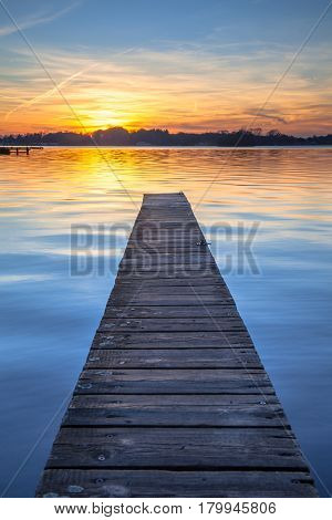 Picturesque Sunset Over Wooden Jetty In Groningen, Netherlands
