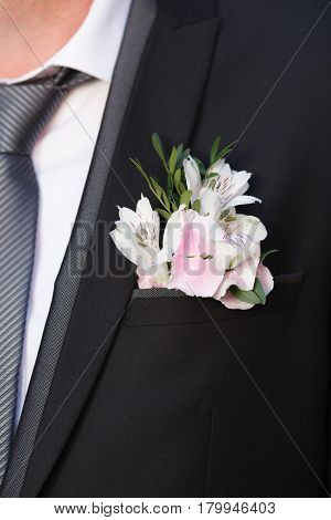 White and pink boutonniere with hydrangea and alstroemeria flower