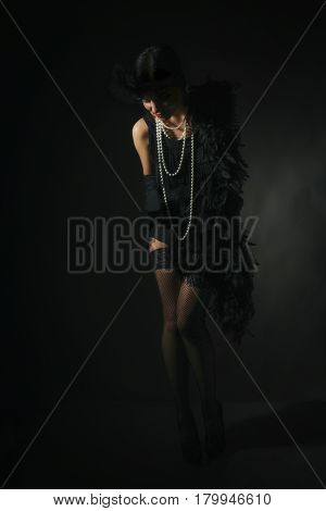 Portrait of a beautiful young woman in style of the great Gatsby of the 20s. Vintage clothing and jewelry