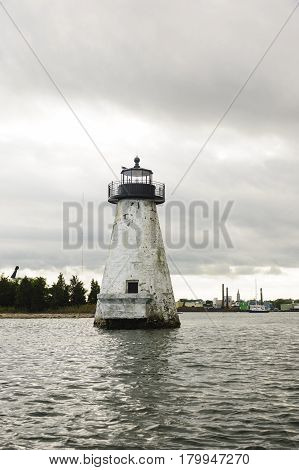 New Bedford Massachusetts USA - August 21 2014: Palmer's Island lighthouse before repainting in New Bedford Massachusetts