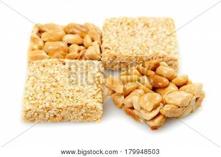 Oriental sweets with nuts on a white background