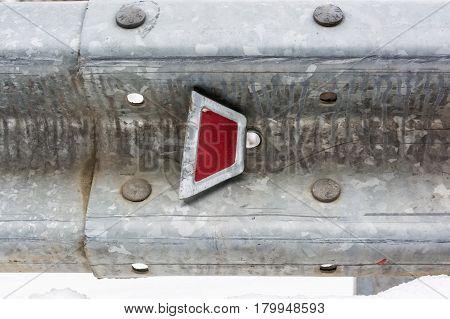 Closeup of metal guard railby the road